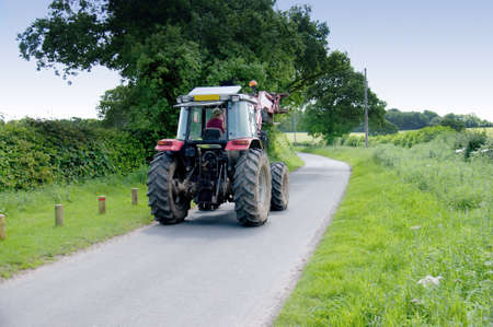 a tractor on a country lane photo
