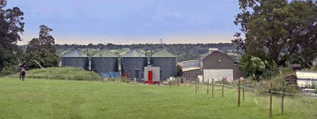 eyesore: storage tanks on farm farming agriculture agricultural landscape country countryside rural feed chemicals grain silo eyesore