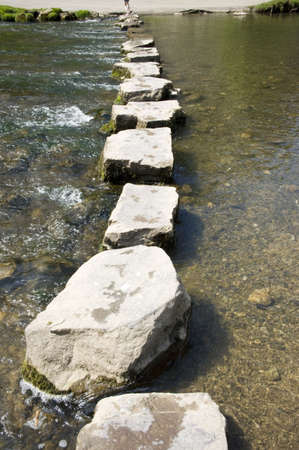 across: Stepping Stones across the river dove peak district Stock Photo