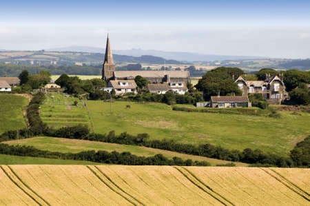 view over devon countryside with fields and farmland photo