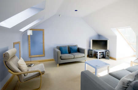 loft living: lounge area in newly restored rebuilt house  Stock Photo