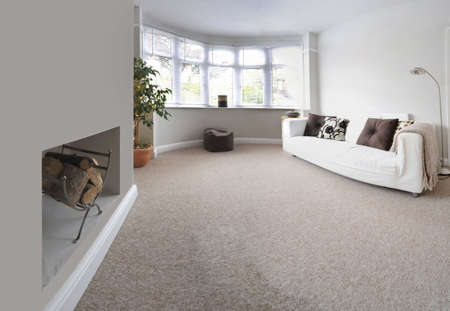 Carpet floor: lounge area in newly restored rebuilt house  Stock Photo
