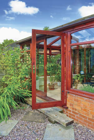 conservatories: conservatory tables chairs plants room in  next to garden