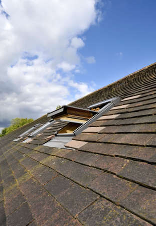 Windows in the roof of a house photo