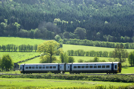 A train on a railway line in the countryside photo