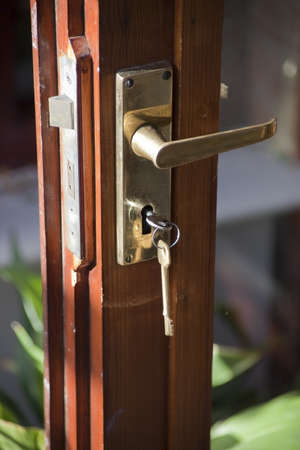 illustrating: A key in door illustrating security