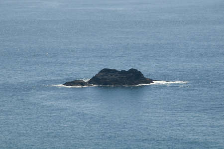 cast off: a rock island in the sea