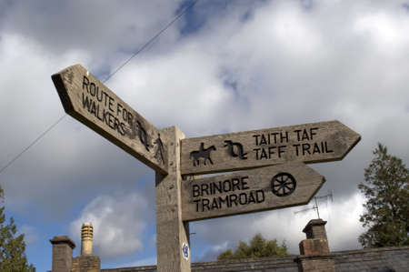 brecon beacons: taff trail signpost alongside monmouthshire and brecon canal brecon beacons national park powys wales uk
