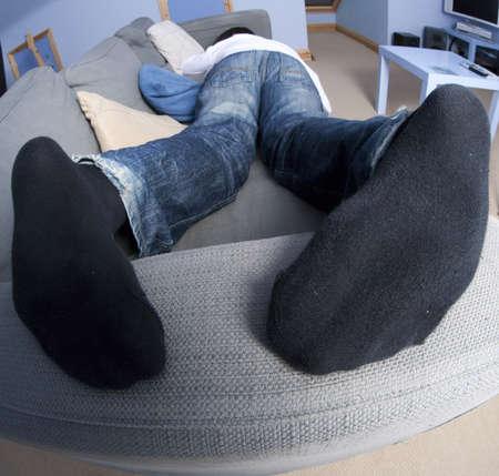 teenage boy sleeping on couch photo