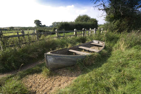 land locked: a wooden boat in the countryside Stock Photo