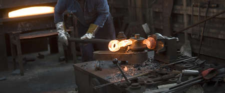 manufactured: Inside a factory making manufactured goods with steel. Stock Photo