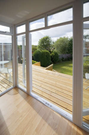 veranda: house with wooden decking and patio leading to garden Stock Photo