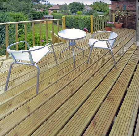 decking: house with wooden decking and patio leading to garden Stock Photo