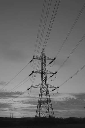 metal pylon carrying electricity supply power lines photo