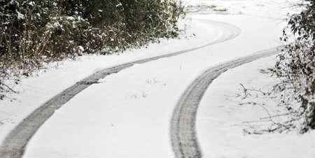 sub zero: car tracks in the snow