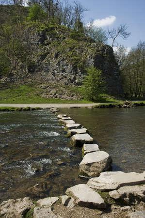 across: Stepping Stones across the river dove peak district Stock Photo