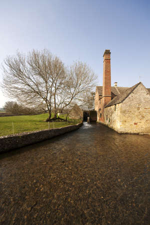 slaughter: A view of lower slaughter village with the river eye and a mill wheel