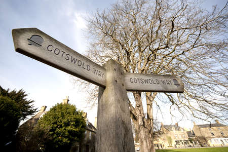 cotswold: a cotswold way sign in the village of broadway worcestershire
