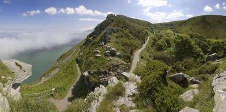lynton: the coast of the valley of the rocks lynton devon with sea fog against the cliffs