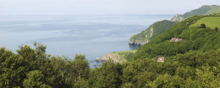 woody bay: the coast of the valley of the rocks lynton devon from the coastal path to lynmouth - looking down on woody bay Stock Photo