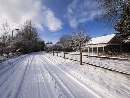 A snow covered rural landscape in a village Stock Photo - 6397259