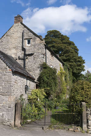 village with houses in countryside - tissington, derbyshire, peak district, national park, england, uk Stock Photo - 6396329