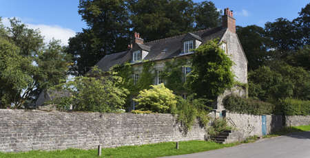 village with houses in countryside - tissington, derbyshire, peak district, national park, england, uk photo
