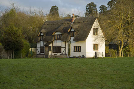 a house in a field in the countryside photo