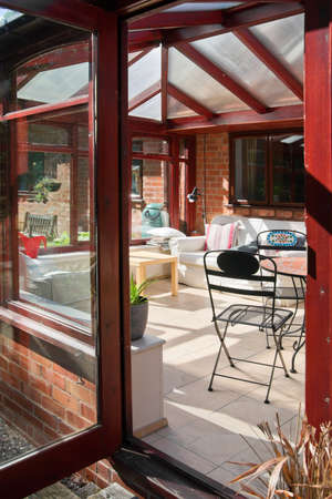 conservatory tables chairs plants room in house next to garden Stock Photo - 9627769