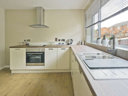 colour image kitchen in newly restored rebuilt house work surfaces photo