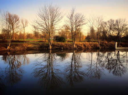 the river thames view across river to the playing fields of eton college berkshire photo