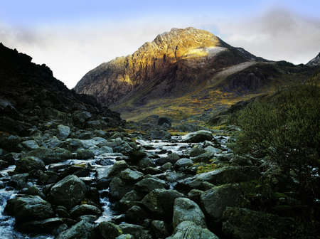 nant: tryfan mountain from waterfall, river ogwen, ogwen falls, nant ffrancon pass, snowdonia national park, wales , uk, gb Stock Photo