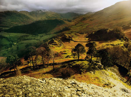 view of borrowdale from the summit of castle crag in the english lake district photo