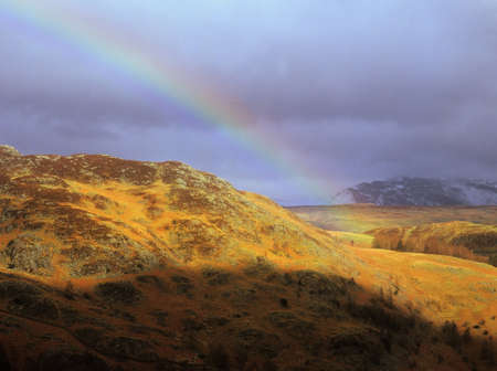 langdale pikes: a full semi-circular rainbow over borrowdale in the english lake district