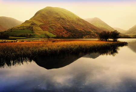 landscapes: lake district national park cumbria england uk - crummock water at sunsrise Stock Photo