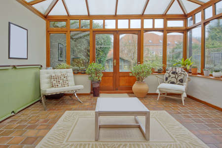 conservatory tables chairs plants room in house next to garden Stock Photo - 12730663