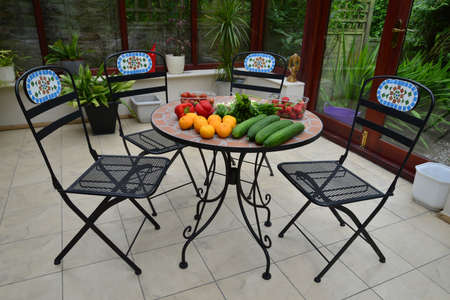 conservatories: fruit and vegetables on a table in a country cottage conservatory Stock Photo