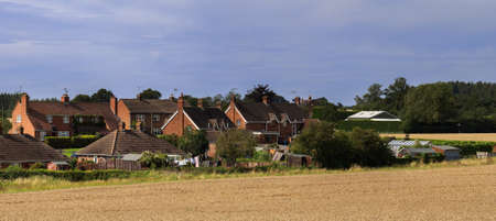 village with houses in countryside photo