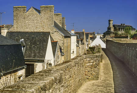 a village with old houses in france - the old walled city of concarneau, finistere, brittany france photo