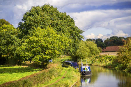 a canal on the inland waterways network of navigable canals and waterways in the english and british countryside in the uk, united kingdom, great britain, europe photo