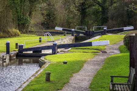 a lock gate on a canal on the inland waterways network of navigable canals and waterways in the english and british countryside in the uk, united kingdom, great britain, europe Stock Photo - 17292206