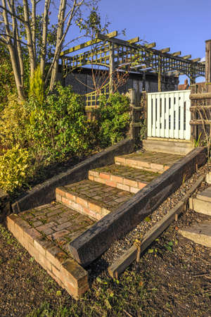 the back gate: steps and gate to a back garden Stock Photo