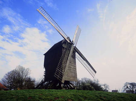 an old wooden windmill photo