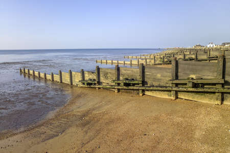 shingle beach: groynes on the shingle beach at whitstable kent Stock Photo