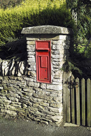 postbox in wall outside house in village Stock Photo - 17948904