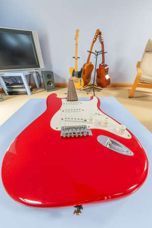stratocaster: red stratocaster guitar in a teenagers bedroom