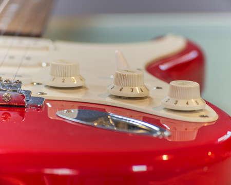 stratocaster: a red stratocaster guitar