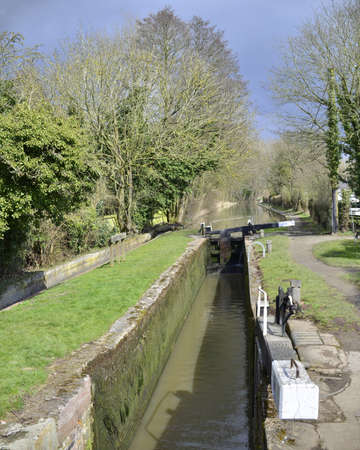 industrial heritage: a lock gate on a canal on the inland waterways network of navigable canals and waterways in the english and british countryside in the uk, united kingdom, great britain, europe Stock Photo