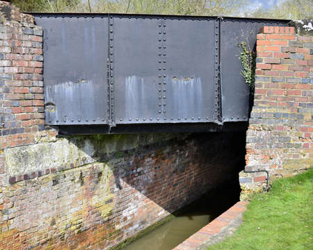 inland waterways: a bridge on a canal on the inland waterways network of navigable canals and waterways in the english and british countryside in the uk, united kingdom, great britain, europe
