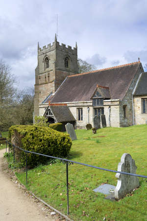 typically english: a country village parish church in england - beoley worcestershire